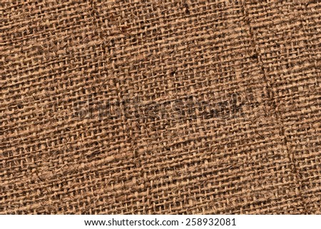 Photograph of raw, roughly woven, coarse grain, burlap grunge texture.  - stock photo