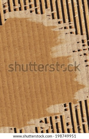 Photograph of recycle brown corrugated striped cardboard, coarse grain, obsolete, torn, grunge texture sample - stock photo