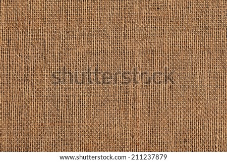 Photograph of roughly woven, extra coarse grain, burlap grunge texture. - stock photo