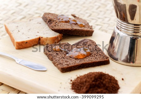 Photograph of some toasted bread with marmalade and other ingredients