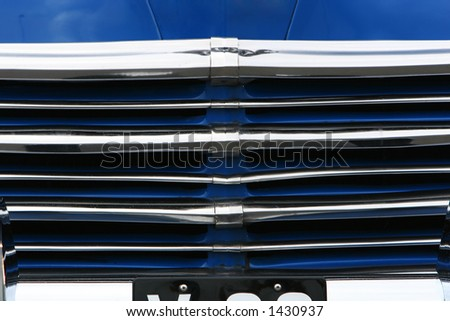photograph of the grill on an old classic car in mint condition, shining chrome and highly polished finish , absolutely beautiful - stock photo