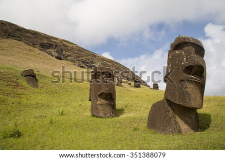 Photograph of the moais at Rano Raraku stone quarry on Easter Island in Chile. - stock photo