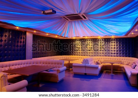 Photograph of the modern lounge area of bar. - stock photo