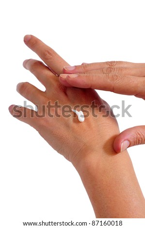 photograph of two women's hands applying cream