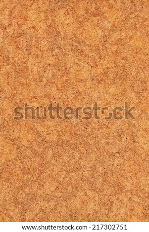Photograph of vivid Ocher recycle paper, extra coarse grain, mottled grunge texture sample. - stock photo