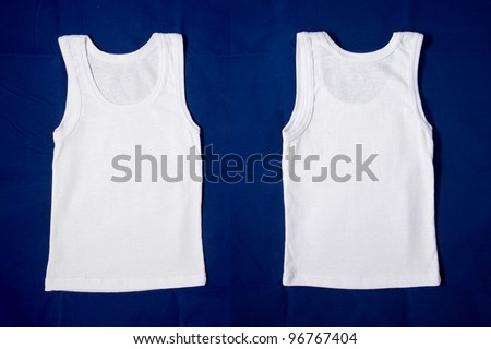 Photograph of wrinkled blank white t-shirts, fronts and backs. Clipping path included. Ready for your design, letters, symbols or logo. Isolated on blue background with clipping path - stock photo