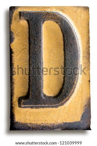 Photograph of Yellow Rubber Stamp Letter D - stock photo