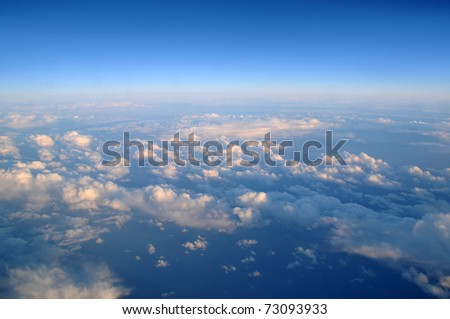 Photograph taken above the clouds over the Pacific Ocean. - stock photo