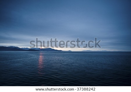 Photographed from a cruise boat at night - stock photo
