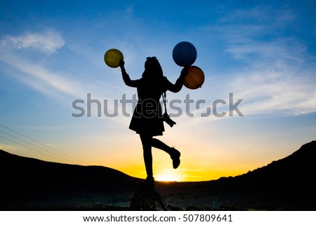 photographer and balloon girl silhouette background