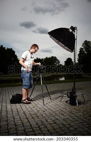 Photographer at work - stock photo