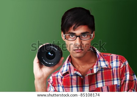 Photographer at work holding lens - stock photo