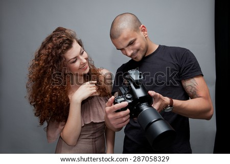 Photographer at work with model in the professional studio