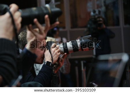 Photographer attend the award winners press conference of the 66th Berlinale Film Festival on February 20, 2016 in Berlin, Germany. - stock photo