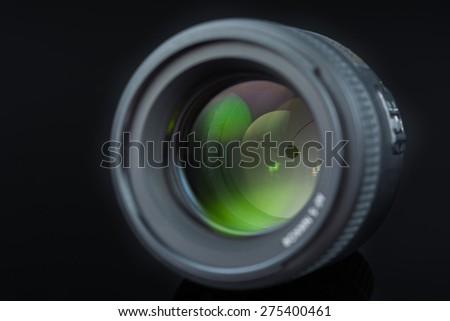 Photographer Camera Lens isolated on black background - stock photo