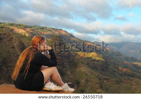 Photographer contemplating the scenic beauty of Hawaii