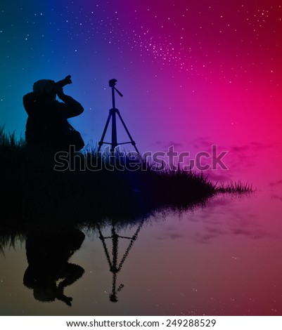Photographer doing a photo of the aurora borealis - stock photo