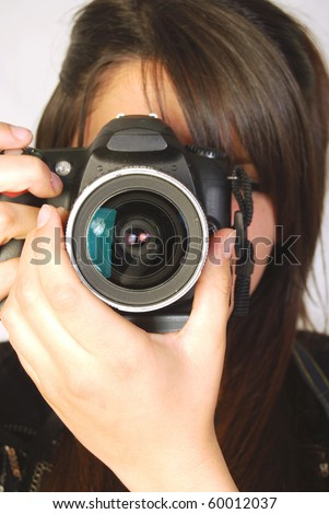 Photographer during a photo shoot,  in a photographer studio - stock photo
