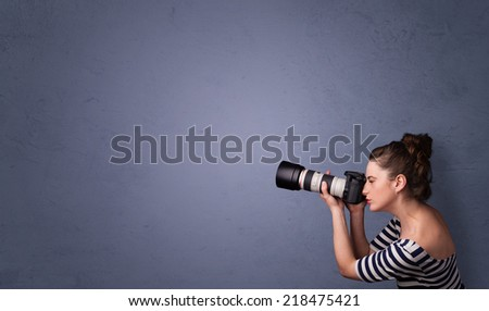 Photographer girl shooting images with copyspace area - stock photo