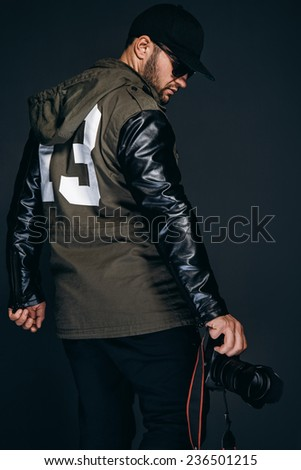 Photographer. Handsome guy with camera - stock photo