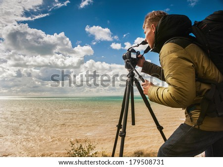 Photographer have shooting session wild sea landscape - stock photo