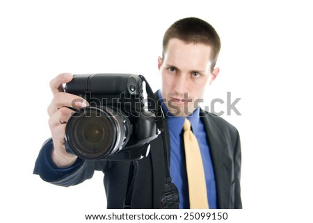 Photographer holds his camera out in front of himself