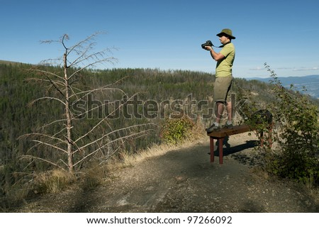 Photographer in Myra Canyon, Kelowna, Canada - stock photo