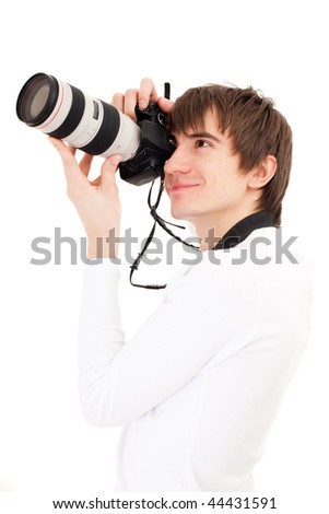 Photographer in white holding phone camera. Isolated over white - stock photo