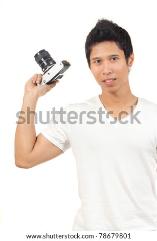 photographer in white shirt holding an old camera - stock photo