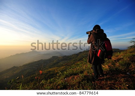 Photographer is shooting the nice view in the morning - stock photo