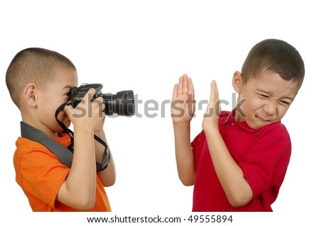 photographer kid taking unwanted paparazzi-style photo, isolated on white background - stock photo