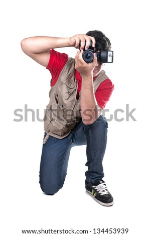 photographer kneeling on white background - stock photo