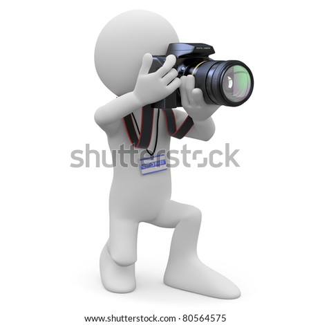 Photographer kneeling with his SLR camera - stock photo