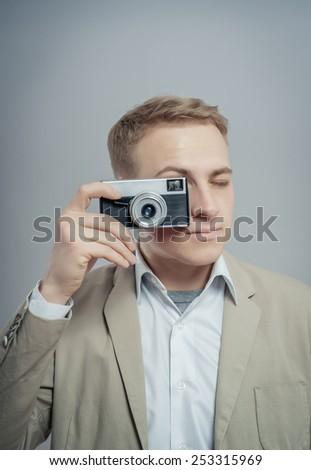 Photographer making a shot - stock photo