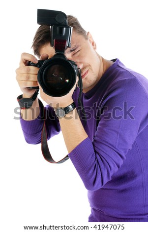 Photographer man with camera posing isolated on the white background - stock photo