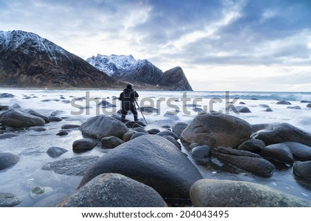 photographer on the lofoten islands, norway - stock photo