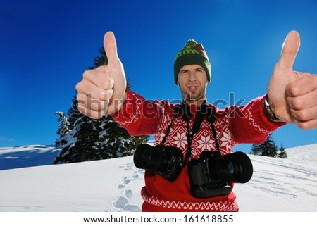 photographer portrait at beautiful winter day with fresh snow - stock photo