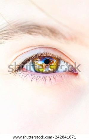 Photographer portrait reflection in open human eye. Outdoors close-up. - stock photo