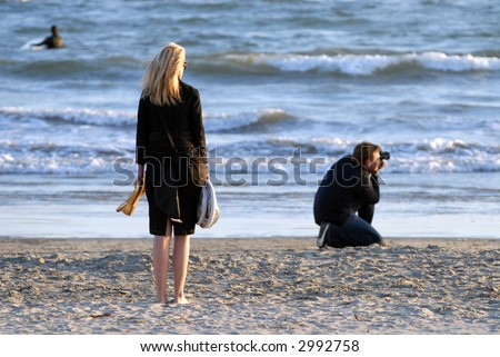 Photographer's Assistant Looks On at a Sunset Shoot
