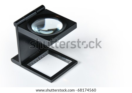 photographer's magnifying glass with white bottom - stock photo