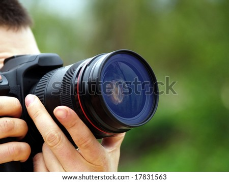 photographer shots with SLR camera - stock photo