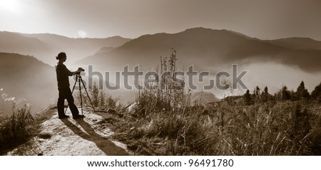 Photographer silhouette, sunrise - stock photo