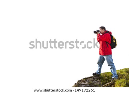photographer standing on the top of mountain isolated on white - stock photo