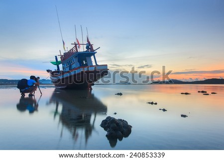 Photographer take a photo sunrise at the Rawai beach in Phuket, Thailand