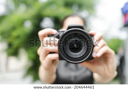 Photographer takes pictures in the open air - stock photo