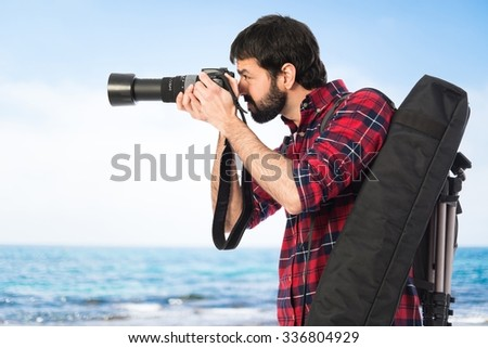 Photographer taking a photo on unfocused background