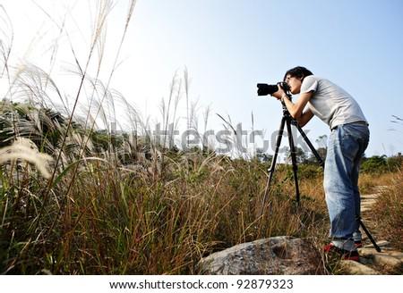 photographer taking photo in wild - stock photo