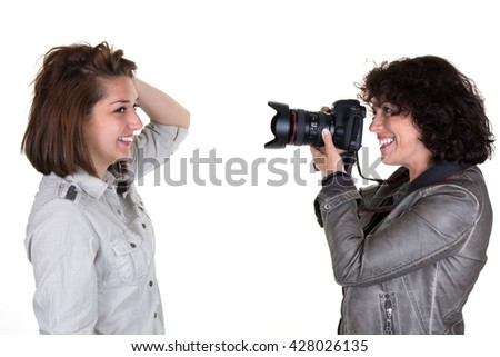 Photographer taking photo of a female model isolated