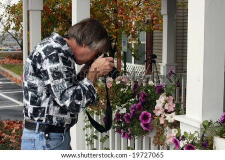 photographer taking photo of outdoor plants