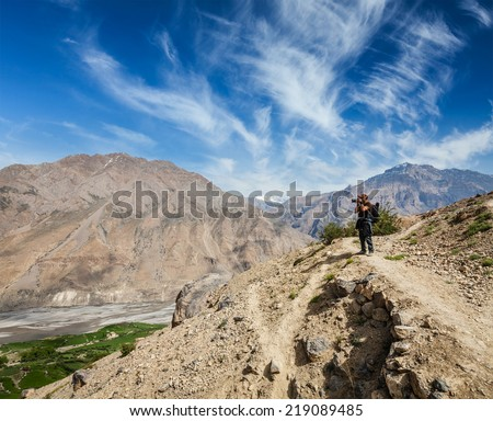 Photographer taking photos in Himalayas mountains. Spiti valley, Himachal Pradesh, India
